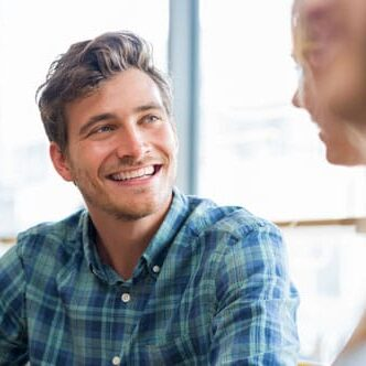 smiling guy in a happy conversation